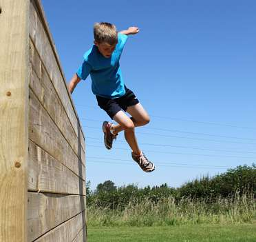 Child jumping over wall