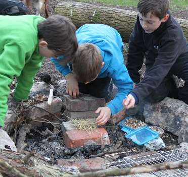 Mojo Active children making fire