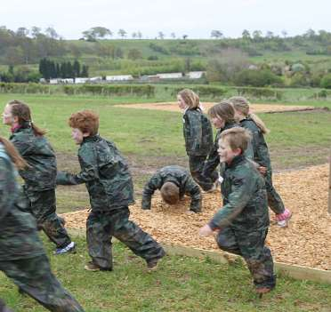 Children having fun on the assault cuorse